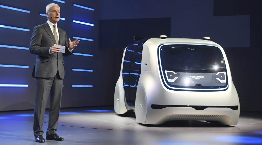 Matthias Mueller, the CEO of Volkswagen, presents VW autonomous concept car Sedric, at the 87th Geneva International Motor Show in Geneva, Switzerland, Monday March 6, 2017. (Uli Deck/dpa via AP)