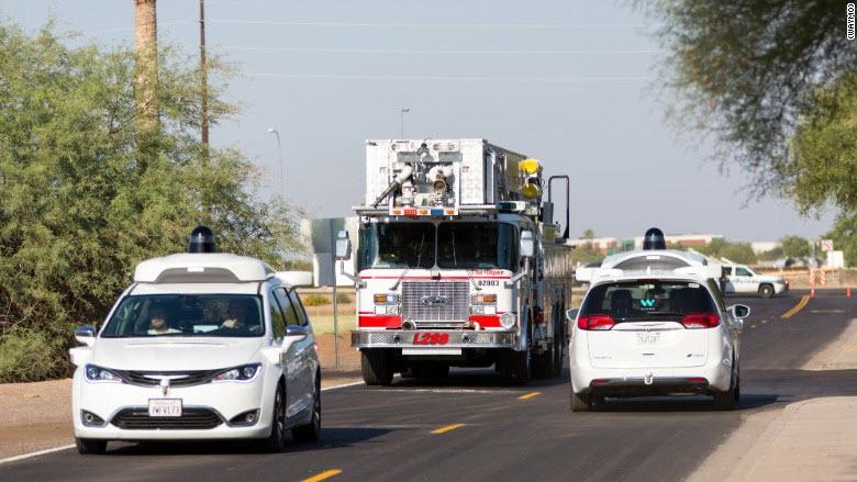 Waymo vans police cars