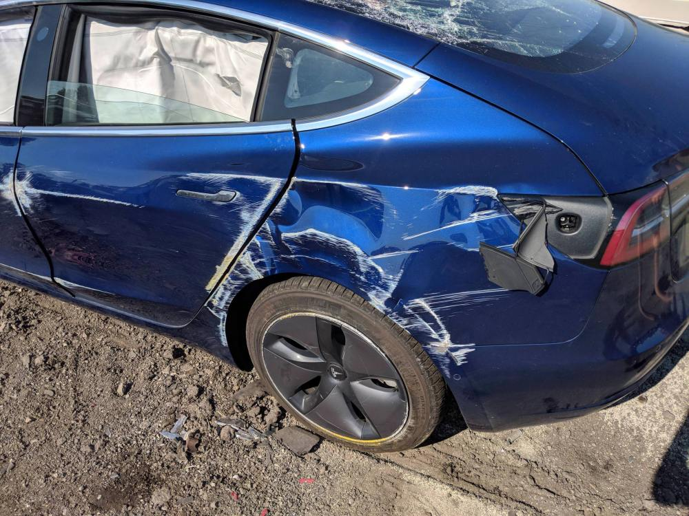 Tesla Model 3 rollover